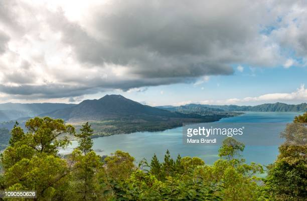 view of lake danau batur, volcano mount batur, bali, indonesia - stratovolcano stock photos and pictures