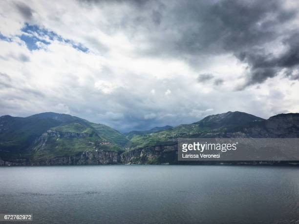 view of lake garda with clouds - larissa veronesi stock pictures, royalty-free photos & images