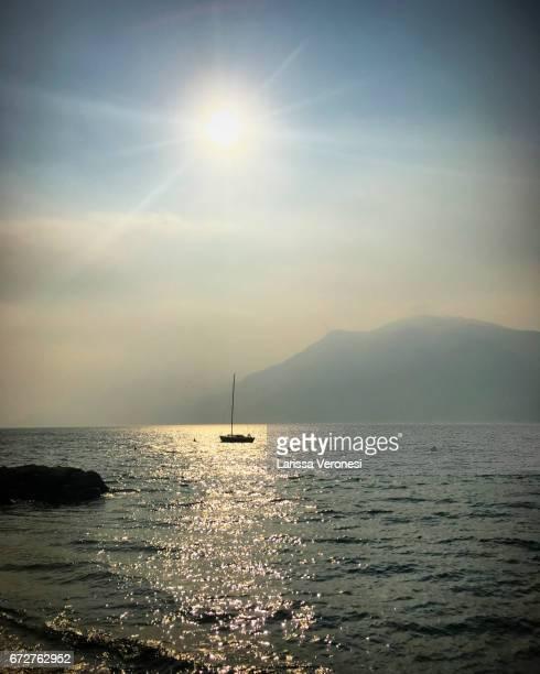 View of Lake Garda with sailboat, Brenzone sul Garda