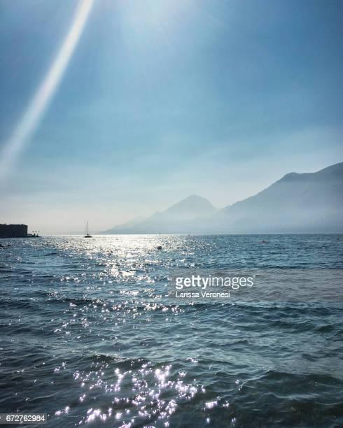 View of Lake Garda with sailboat, Porto, Brenzone sul Garda