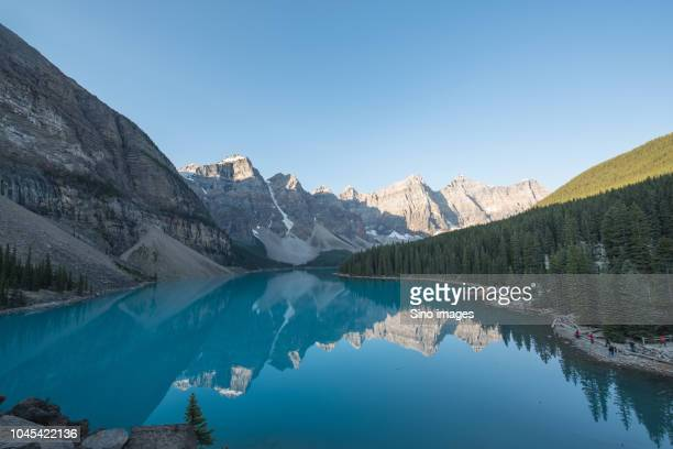 view of lake in mountains against clear sky, canada - image stock pictures, royalty-free photos & images