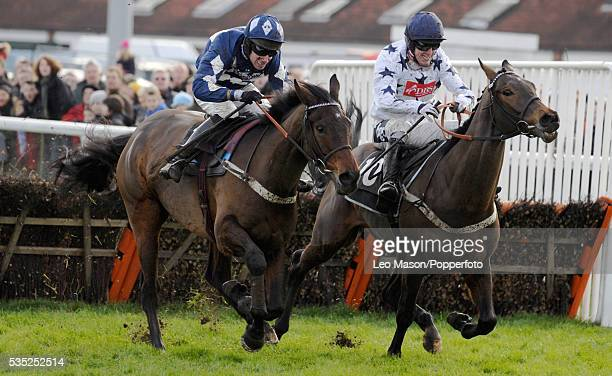 View of Lake Legend and Wayne Hutchinson racing Erzen and Tony McCoy to win the Williamhillcom Sports Betting Handicap Hurdle during the 2009...