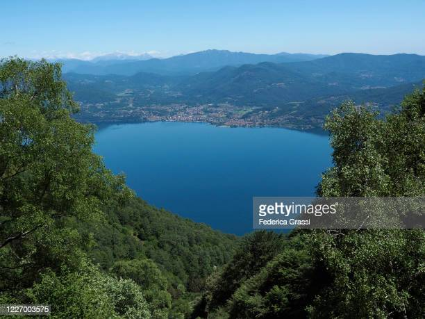 view of lake maggiore and the city of luino (province of varese) - province of verbano cusio ossola stock pictures, royalty-free photos & images