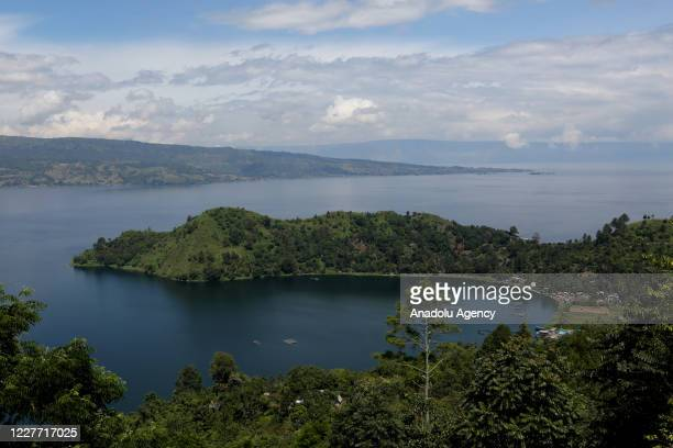 View of Lake Toba is seen from the Parapat area in Simalungun District, North Sumatra, Indonesia on July 21, 2020. Lake Toba has become one of the...