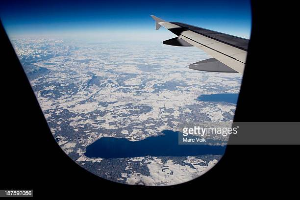 View of lakes within a snowy landscape from an airplane, Bavaria, Germany