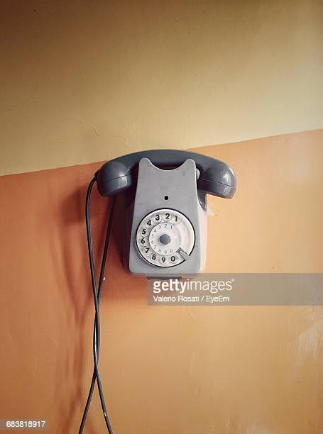 View Of Landline Telephone Next To Wall