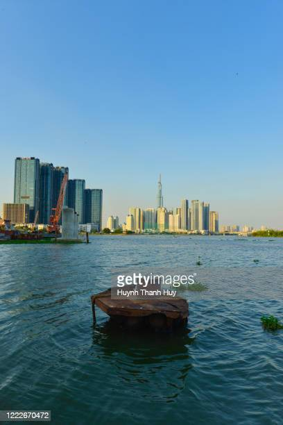 a view of landmark 81 building from bach dang port - saigon river stock pictures, royalty-free photos & images