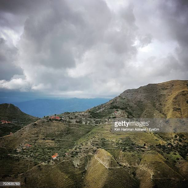 view of landscape against cloudy sky - kim hartman stock photos and pictures