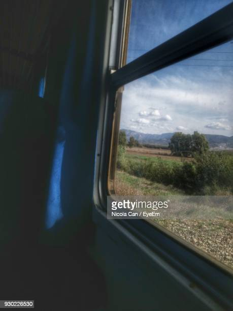 View Of Landscape Seen Through Train Window