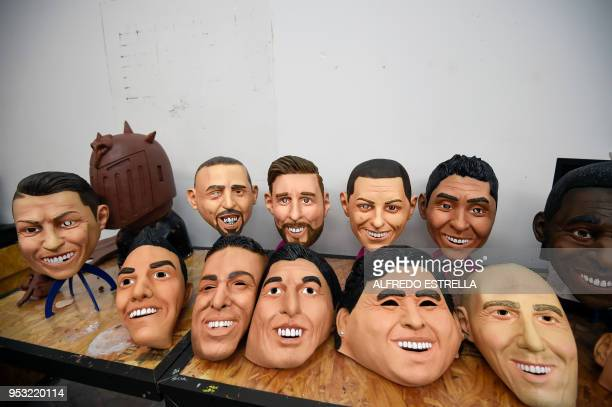 View of latex masks of football players Cristiano Ronaldo Franck Ribery Lionel Messi Javier Hernandez Jorge Campos Pele Hirving Lozano Neymar Luis...