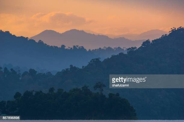 view of layer of mountains during beautiful golden sunrise - shaifulzamri stock pictures, royalty-free photos & images