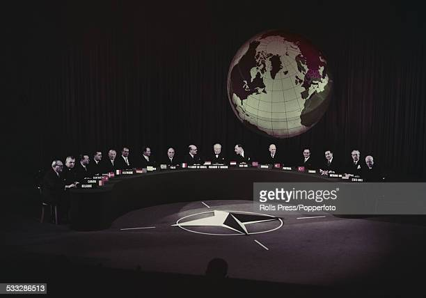 View of leaders of NATO member states including United States President Dwight D Eisenhower on far right and United Kingdom Prime Minister Harold...