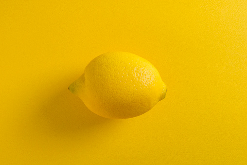 View of lemon on yellow background - gettyimageskorea