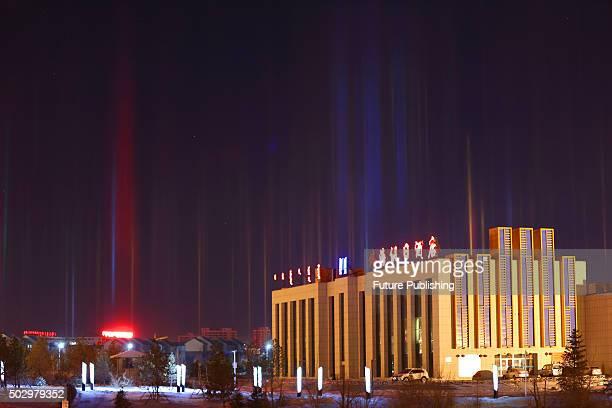 A view of light pillars an atmospheric optical phenomenon seen on December 30 2015 in Xilinhot China Light pillars appear when light bounces off the...