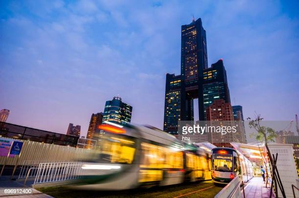 Kaohsiung, Taiwan - November 25 : View of light rail tram and the skyline in Kaohsiung, Taiwan on November 25, 2016. The light rail system in Kaohsiung is the first light rail transit in Taiwan.