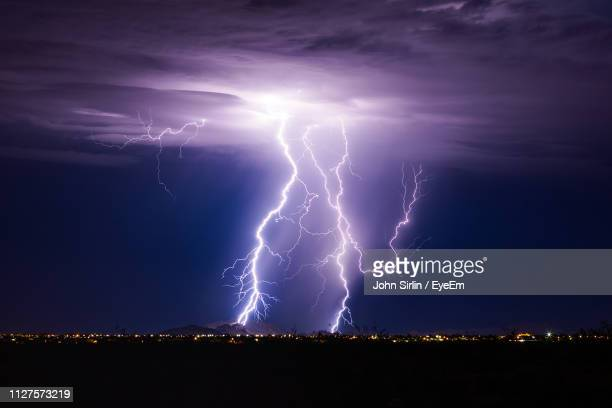 view of lightning in sky at night - lightning stock pictures, royalty-free photos & images