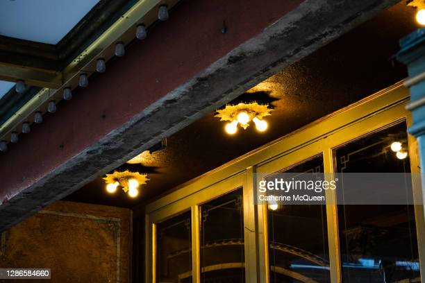 view of lights under main awning at small town performing arts theater - performing arts center stock pictures, royalty-free photos & images