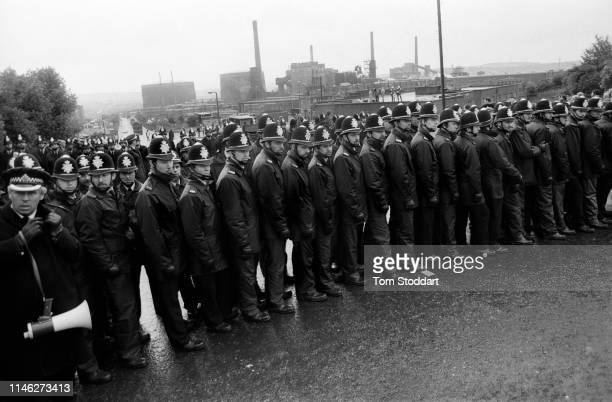 View of lines of police officers as they block the road to near the Orgreave coking plant Orgreave Yorkshire England May 1984 Though the mine's...