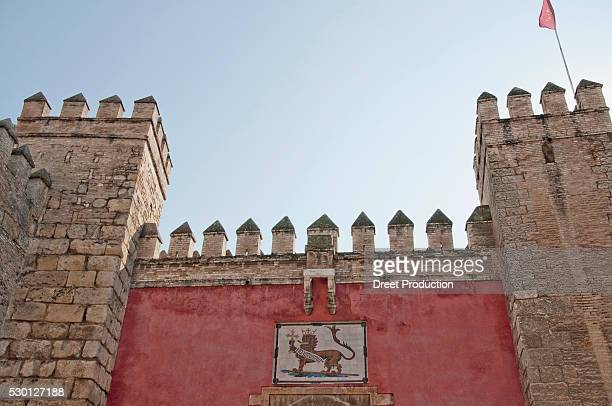 View of Lions gate at Alcazar palace, Sevilla, Andalusia, Spain