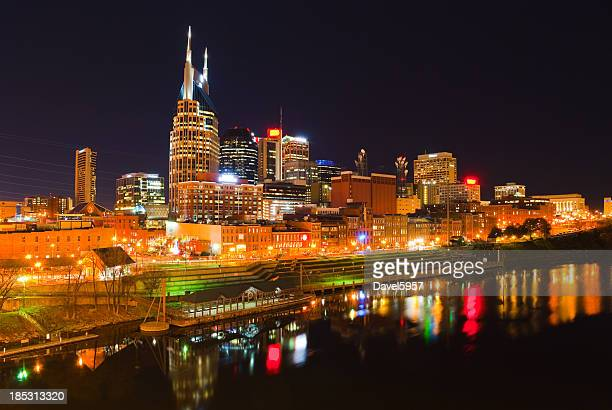 View of lit Nashville skyline at night from the water