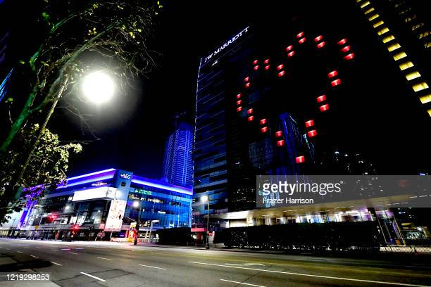 A view of LA Live and JW Marriott Hotel displaying a heart on April 16 2020 in Downtown Los Angeles United States Landmarks and buildings across the...