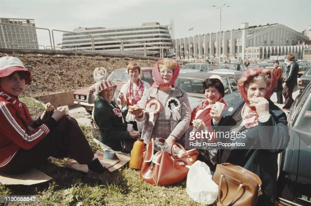 View of Liverpool football fans and supporters enjoying a picnic in the carpark outside Wembley prior to watching play between Liverpool and...