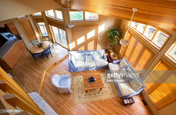 view of living room and dining room from loft - tall high stock pictures, royalty-free photos & images