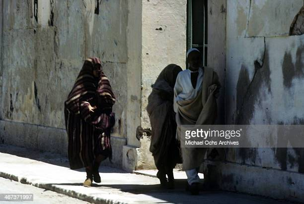 A view of local Libyanese women and man wearing regional clothes walking in the street in Benghazi Libya