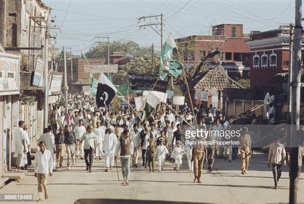 View of local residents of Dacca in East Pakistan holding a demonstration march on the streets to protest against 'Indian agression' and to express...