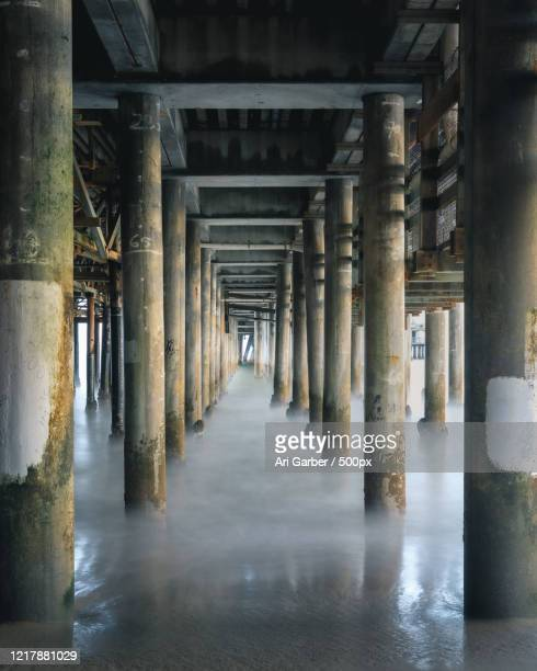 view of logs under pier, santa monica, california, usa - santa monica stock pictures, royalty-free photos & images