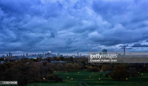 view of london from hampstead heath park at dusk - hampstead heath stock pictures, royalty-free photos & images