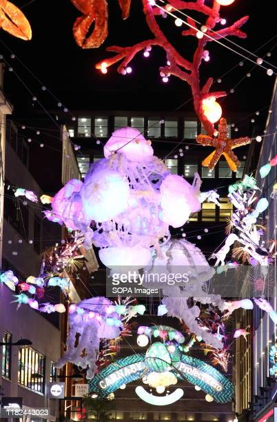 A view of London's iconic Carnaby Street Christmas lights switched on This years Christmas lights are different from previous years with a message in...