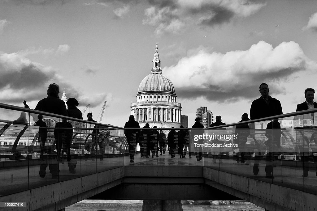 A view of London's Millennium Bridge which crosses the River Thames and links the Tate Modern and Globe Theatre on the south side of the river with St Pauls Cathedral on the north side. Londoners call the bridge the Wobbly Bridge as it began to sway shortly after it opened in June 2000. The bridge was closed for two years while modifications were carried out to stop the movement.