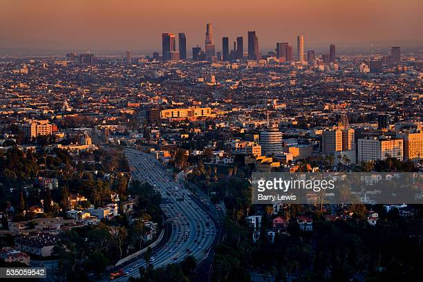 View of Los Angeles at dusk taken from Beverly Hills Mulholland Drive The high rise offices of downtown are in the background Hollywood in the...