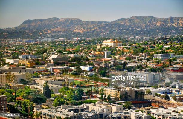 view of los angeles to the hollywood hills - hollywood hills stock pictures, royalty-free photos & images