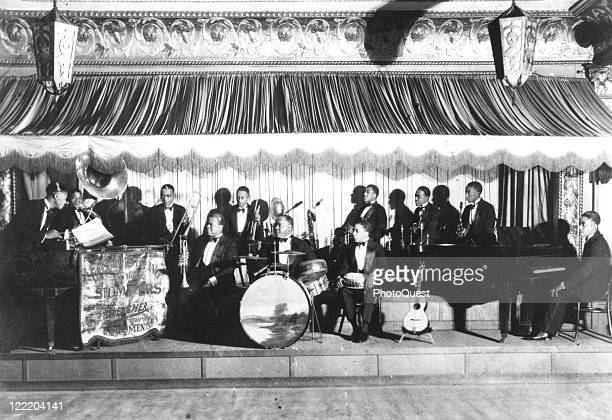 View of Louis Armstrong and his Stompers at the Sunset Cafe, Chicago, Illinois, 1927. Armstrong seats fourth from left.