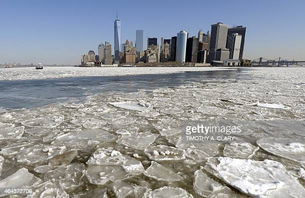 A view of Lower Manhattan is seen on February 25 2015 as the New York Harbor is filled with large chunks of ice AFP PHOTO / TIMOTHY A CLARY