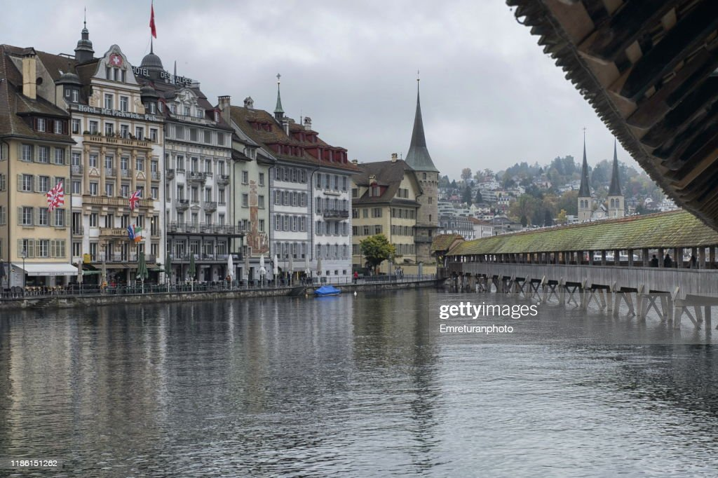 View of Lucerne town shores on Reuss river from Chapel bridge. : Stock Photo