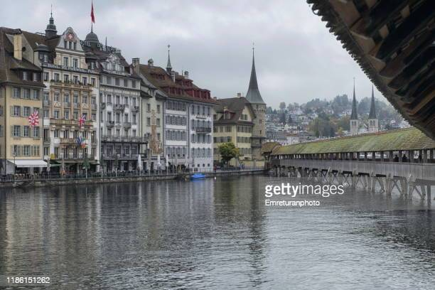 view of lucerne town shores on reuss river from chapel bridge. - emreturanphoto stock pictures, royalty-free photos & images