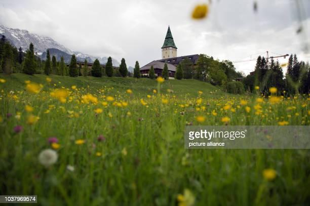 View of luxury hotel Schloss Elmau near the village Kruen near Garmisch-Partenkirchen, Germany, 02 June 2014. Photo: Peter Kneffel/dpa | usage...
