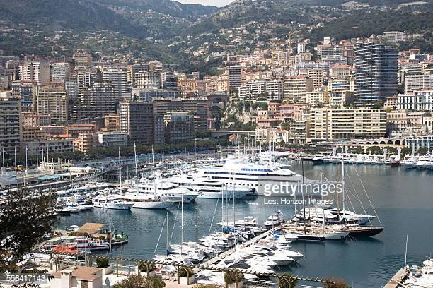 view of luxury yachts moored in harbor, montecarlo, monaco - montecarlo foto e immagini stock