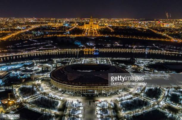 TOPSHOT A view of Luzhniki stadium with the lights turned off for the Earth Hour environmental campaign in Moscow on March 24 2018 / AFP PHOTO /...