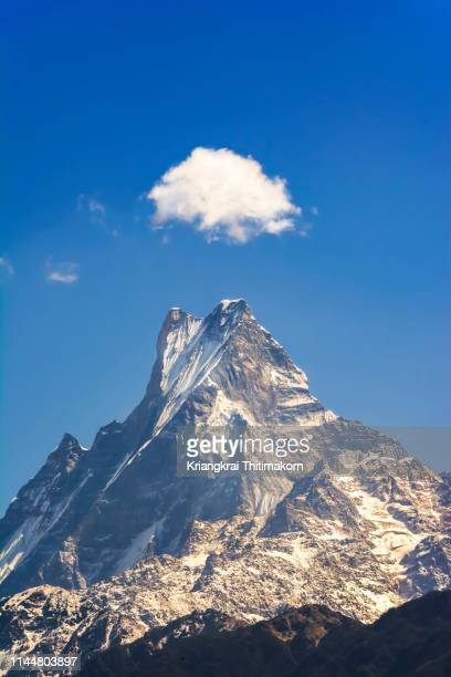 view of machapuchare mountain. - machapuchare stock photos and pictures