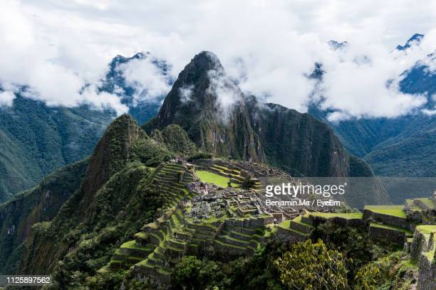 view of machu picchu against sky - ancient civilization stock pictures, royalty-free photos & images