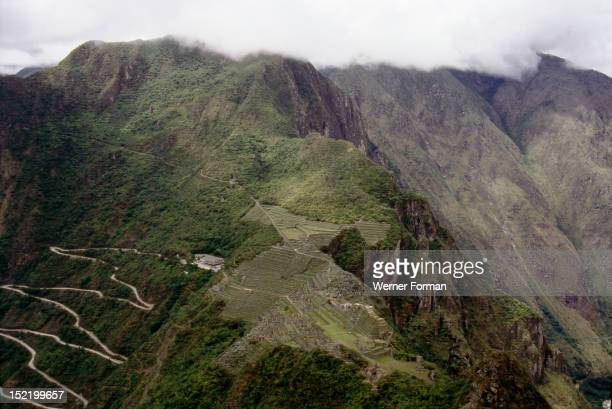 View of Machu Picchu and the modern access road from the summit of Huayna Picchu,Machu Picchu was an Inca city north of Cuzco which was never found...
