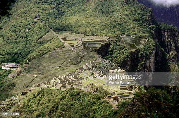 View of Machu Picchu from the summit of Huayna Picchu, showing the dramatic location of the city and its terrace system, Peru. Inca. Pre-Columbian....