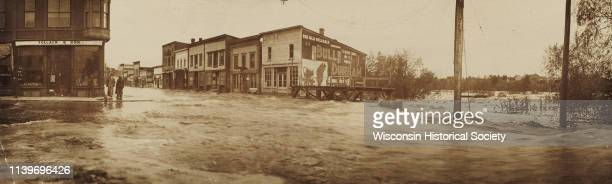 View of Main and Water Streets while experiencing severe flooding Black River Falls Wisconsin 1911