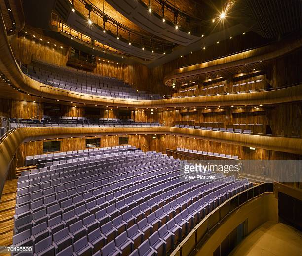 View of main auditorium showing black American walnut finishings and purple leather seats, Wexford Opera House, Concert Hall, Europe, Ireland,...