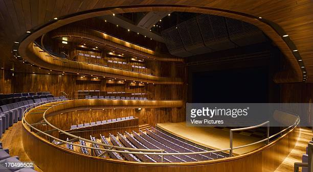 View of main auditorium showing 'horseshoe' of seating with orchestra pit closed, with black American walnut finishings and purple leath, Wexford...