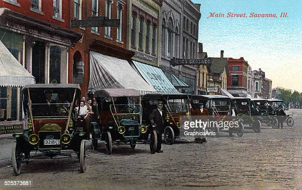 View of Main Street Savanna Illinois with rows of Model T cars colored print from a photograph 1916